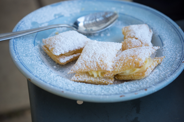 "Sporcamussi (puff pastry filled with pastry cream), the name means ""dirties your face)"