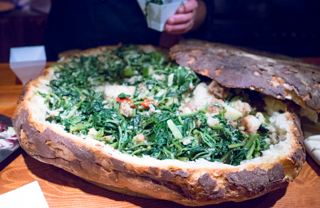 Pancotto (bread filled with boiled broccoli rabe, onions, wild chicory, cabbage, cherry tomatoes, garlic, bay leaves and chilli served with olive oil)