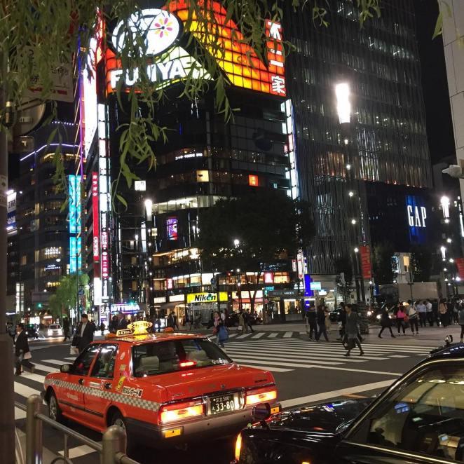 Ginza at night busy intersection in Tokyo travelgram travelgram traveldiaries