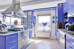 Spectacular blue kitchen with modern chimney