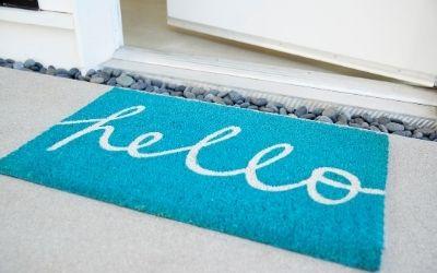 blue mat in front of house door
