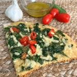 Spinach and tomato pizza recipe. What can you make with spinach and tomatoes? White pizza of course! This delicious pizza recipe can easily be customized for dairy-free, gluten-free, keto, organic, or grain-free diets. Add chicken or bacon for a pizza meal! Easy, healthy spinach and tomato white pizza recipe #pizza #food #recipes #healthy #dairyfree #organic #grainfree #keto #lowcarb #tomato #spinach #garlic #whitepizza #lunchideas #dinner
