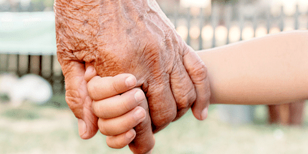 grandparents hand holding with kids