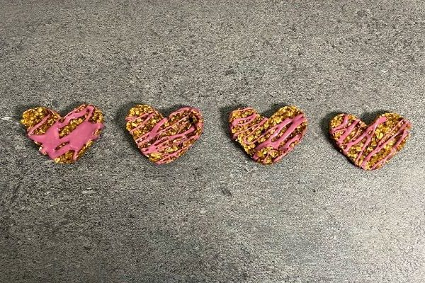 heart shaped oatmeal cookies in a line