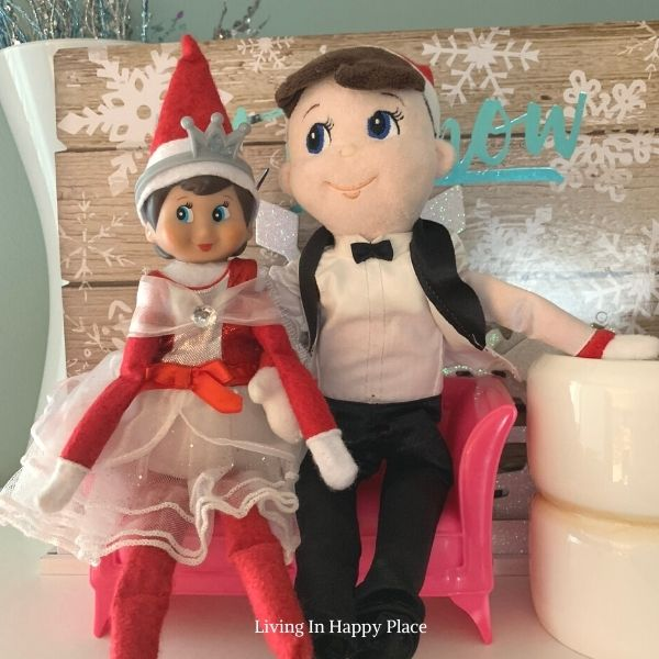 two Elf on the Shelf plushes wearing fancy clothing