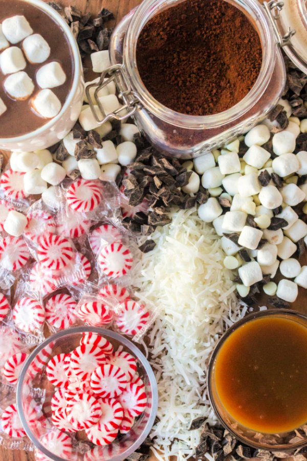 Hot chocolate board with peppermints marshmallows and syrups
