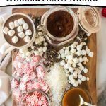 wooden board with hot chocolate marshmallows peppermints and syrups