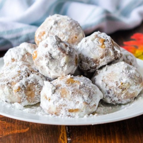 snowball cookies on a white plate