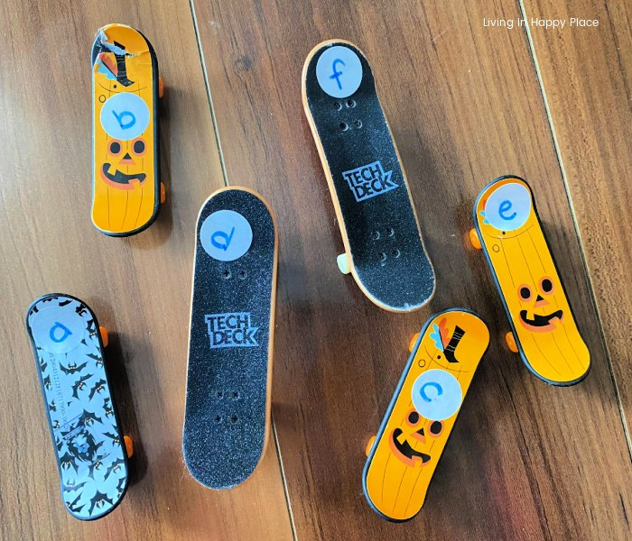finger skateboards with stickers on them and letters