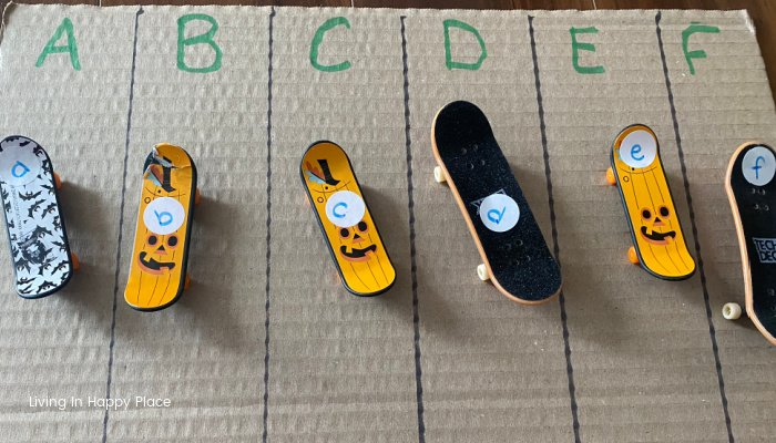 finger skateboards with letters on cardboard with lines