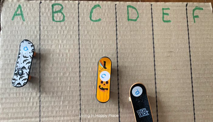 fingerboards with letters on cardboard