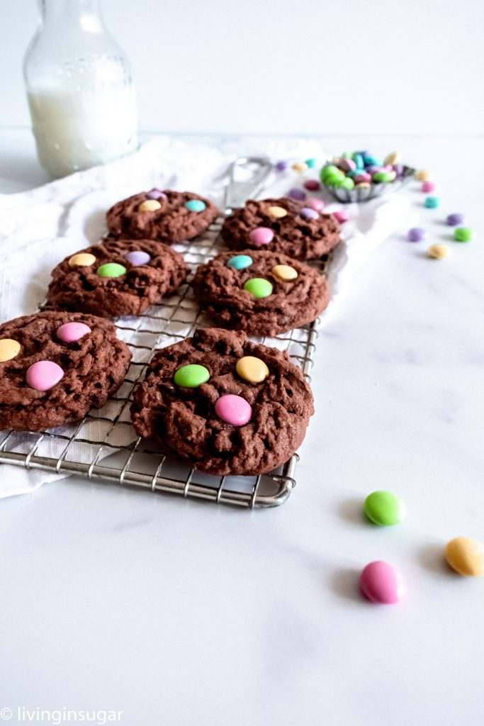 Chocoalte Easter Cookies on a cooling rack with milk in the background