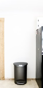 trash can on blank white wall