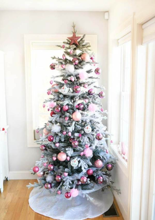 flocked Christmas tree decorated with pink ornaments and tulle for Valentine's Day