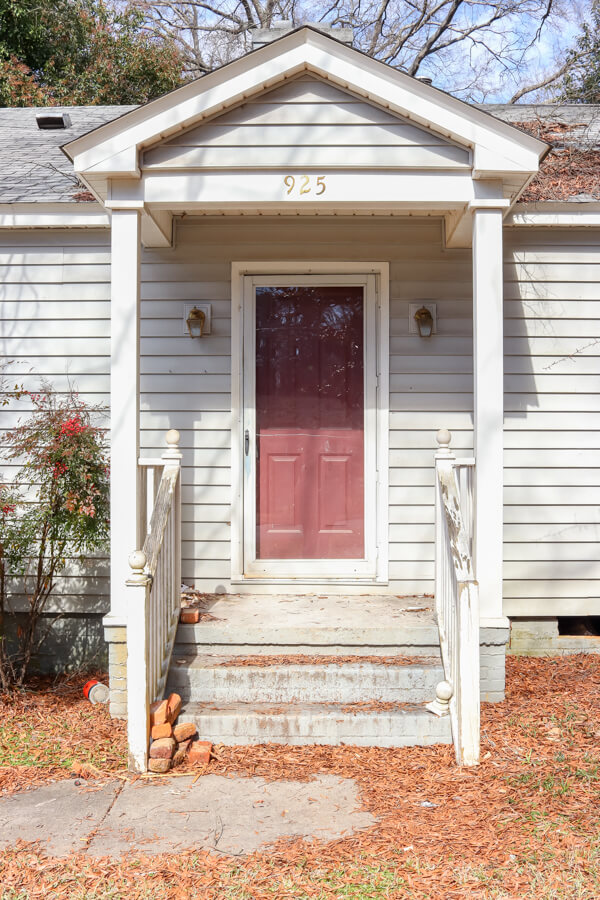 closeup view of small front porch entrance with red door