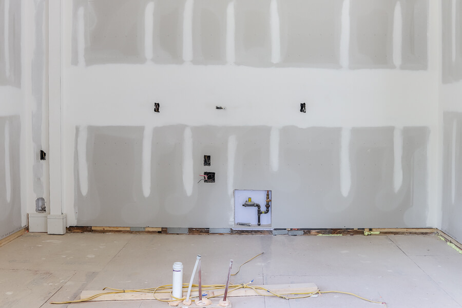 unpainted drywall in kitchen in investment property flip house