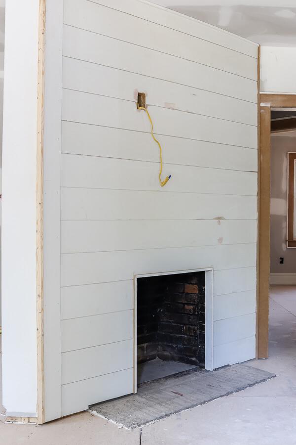 white shiplap fireplace unfinished