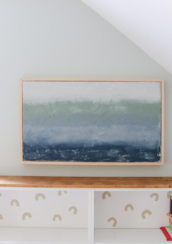 DIY canvas abstract art hanging on wall over IKEA Billy bookcases