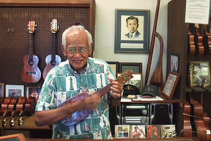 Fred Kamaka Sr.,son of Sam Kamaka, holding Kamaka's signature pineapple ukulele. photo credit: starbulletin.com