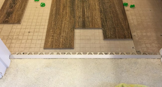 Living on Saltwater - Guest Bathroom Tiling - Transition Piece