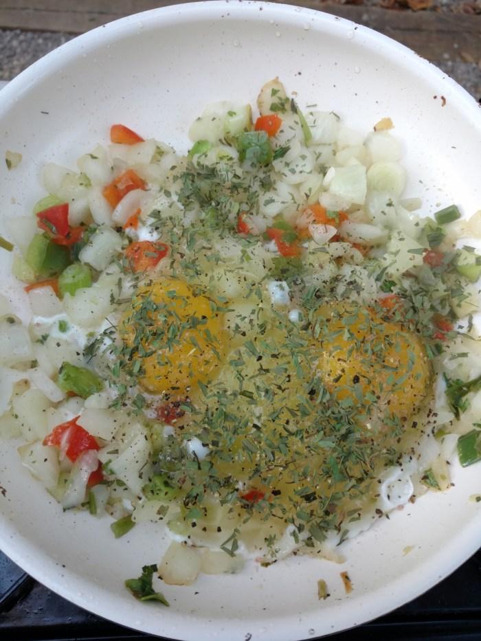 Preparing eggs in the van kitchen