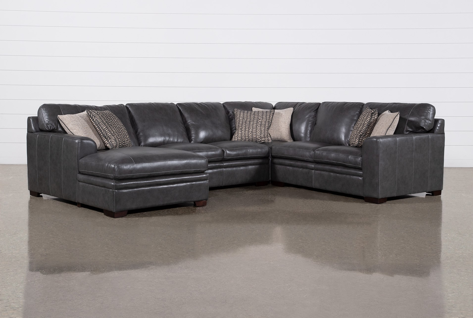 greer dark grey leather 4 piece 143 sectional with left arm facing chaise armless loveseat