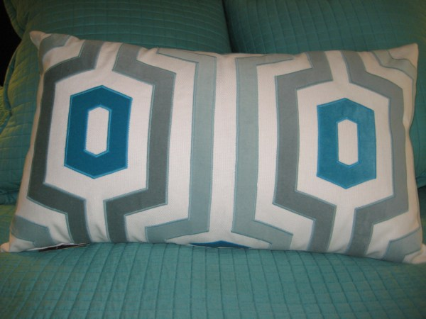 Aqua and cream geometric pillow