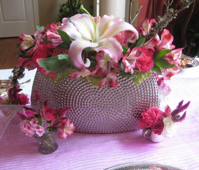 Floral arrangement in modern raised dot container