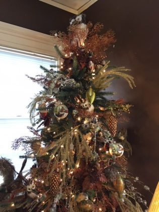 Christmas tree with owls, pinecones, and feathers