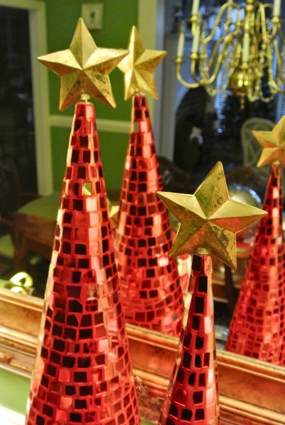 Christmas Decorating Is Easy With Cone Shaped Trees- Red mirrored glass christmas tree with gold stars