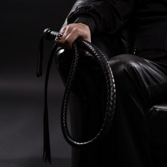 "Liz BlackX  BDSM 101"" Dominance - Do I have to be strict and in leather?  male hand holding black leather whip"