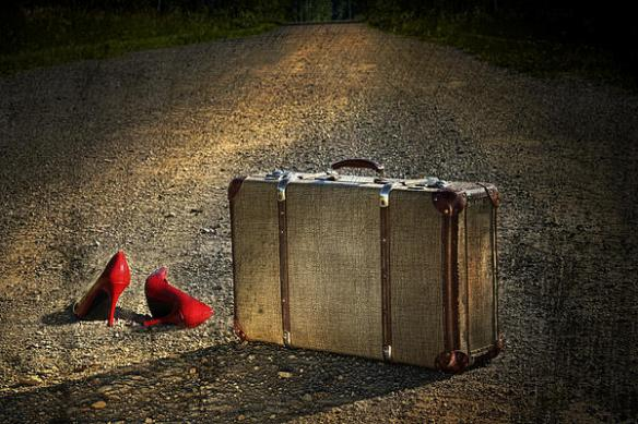 old-suitcase-with-red-shoes-left-on-road-sandra-cunningham