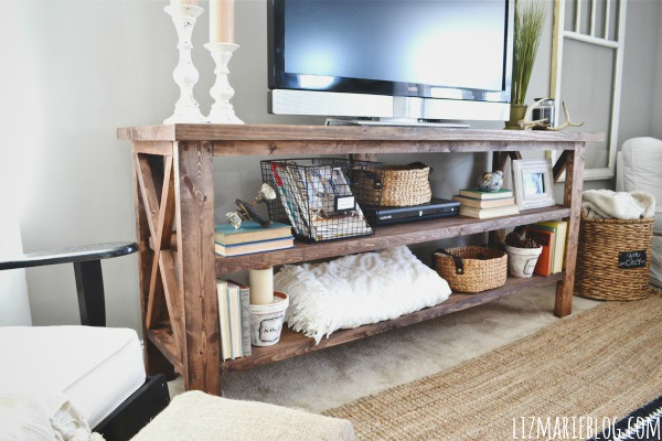 As far as styling this lovely TV console, I keep moving stuff around as  always & it certainly isn't finished, but I like the eclectic look it has  right ...