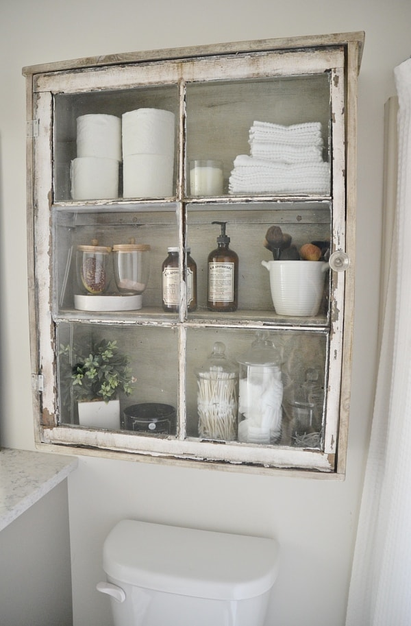 DIY antique window cabinet- See how to make this super easy antique window cabinet. Great for bathroom storage or any room in your home!
