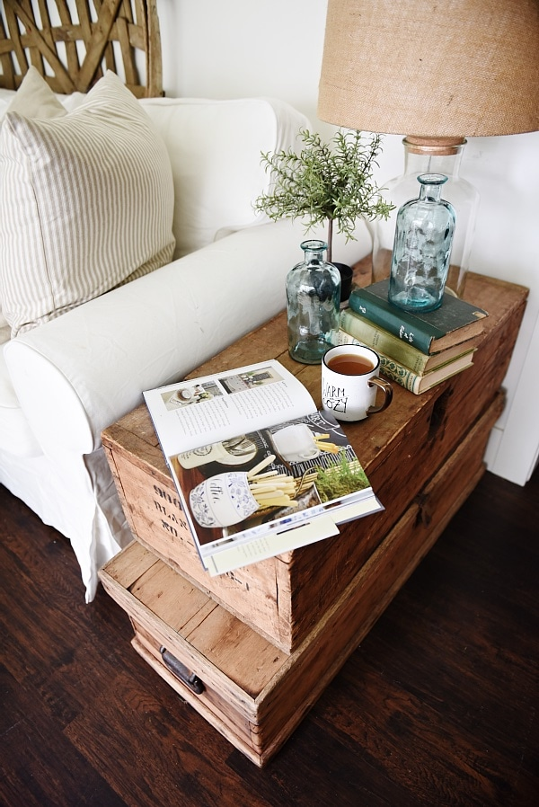 Lovely Neutral Cottage Style Living Room   Stacked Trunk End Table. Cozy  Rustic Farmhouse Style