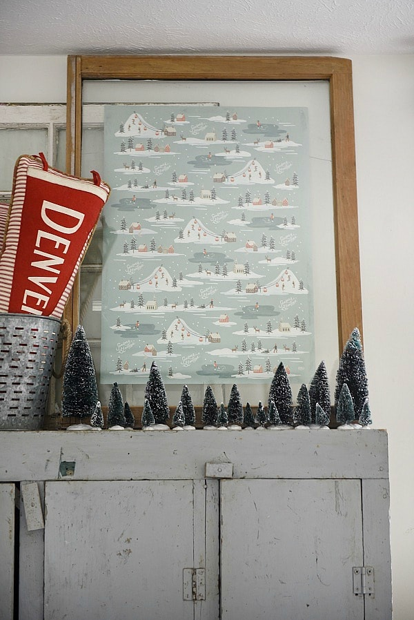 DIY wrapping paper art - Use wrapping paper scraps to create cheap & easy DIY art for the holidays! Would be great to cover up art in gallery walls, place on mantels, & more! Would work great for any season with seasonal wrapping paper.