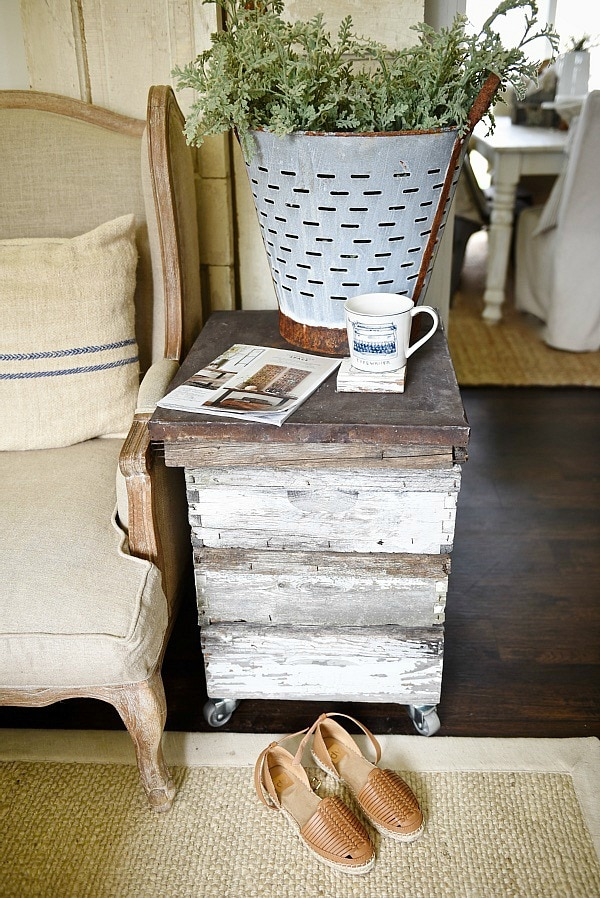DIY rustic beehive end table - A must pin to make an easy rustic end table out of some antique finds. Great for farmhouse style living rooms!