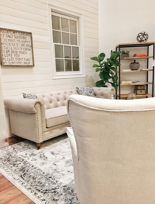 neutral living room decor with a shiplap wall - great cottage & farmhouse style inspiration!