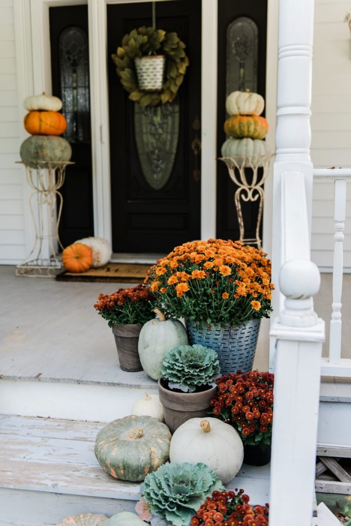 Rustic fall farmhouse porch = Pumpkins & mums on porch stairs. Great inspiration for cottage style & farmhouse style fall decor.
