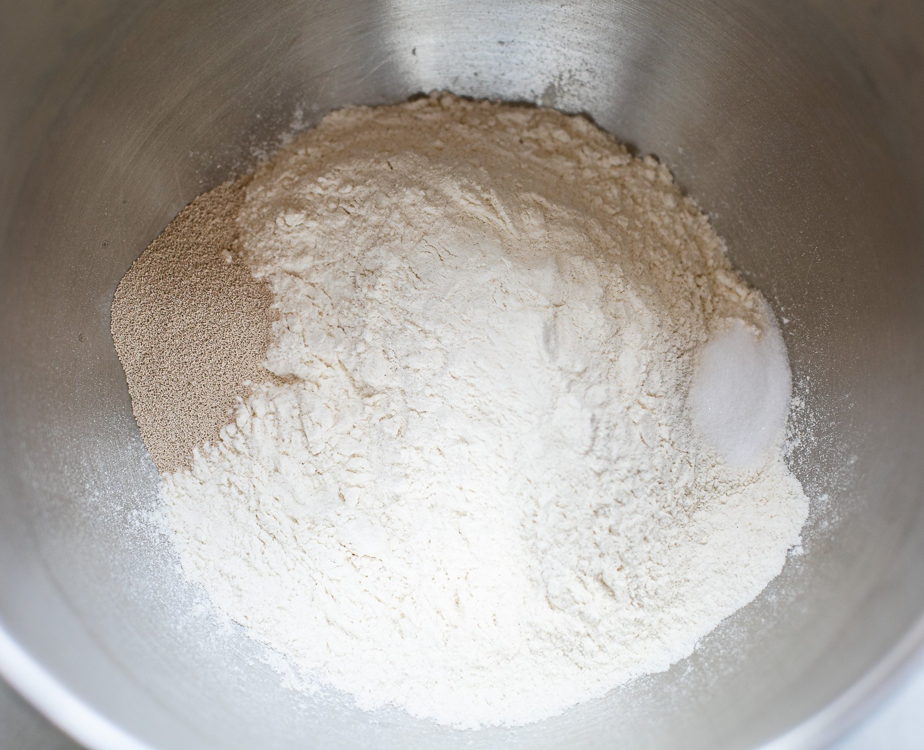 Flour yeast and salt in a mixer bowl to make French baguettes