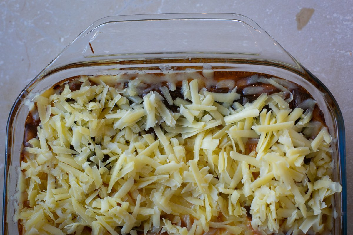 cheese layer added to homemade lasagne