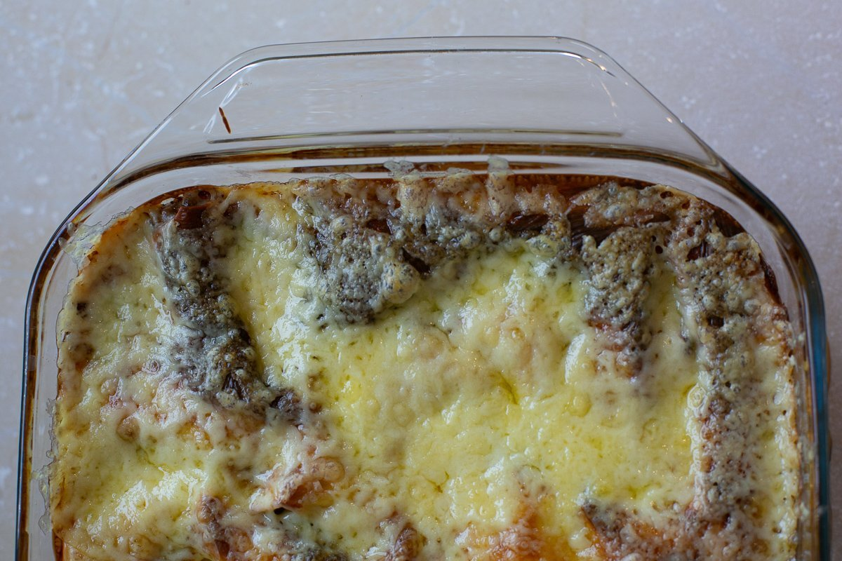 freshly made homemade lasagne in a dish with melted cheese
