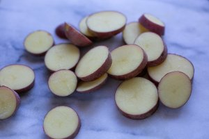 sliced potato for curried aubergine and potato