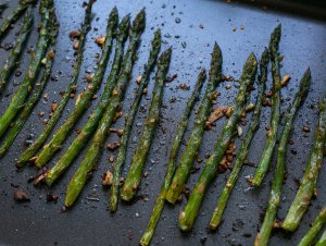 spicy roasted asparagus on a baking sheet
