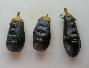 Whole aubergines cooling to be cut up for baba ganoush