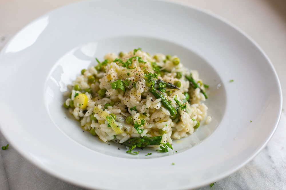 Asparagus Pea and Leek Risotto served in a pasta dish