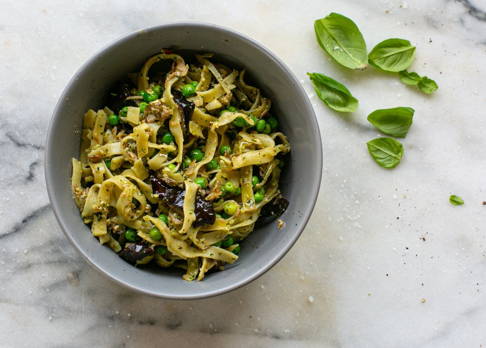 Freshly served aubergine pesto pasta in a bowl