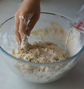 water being added to maneesh bread dough