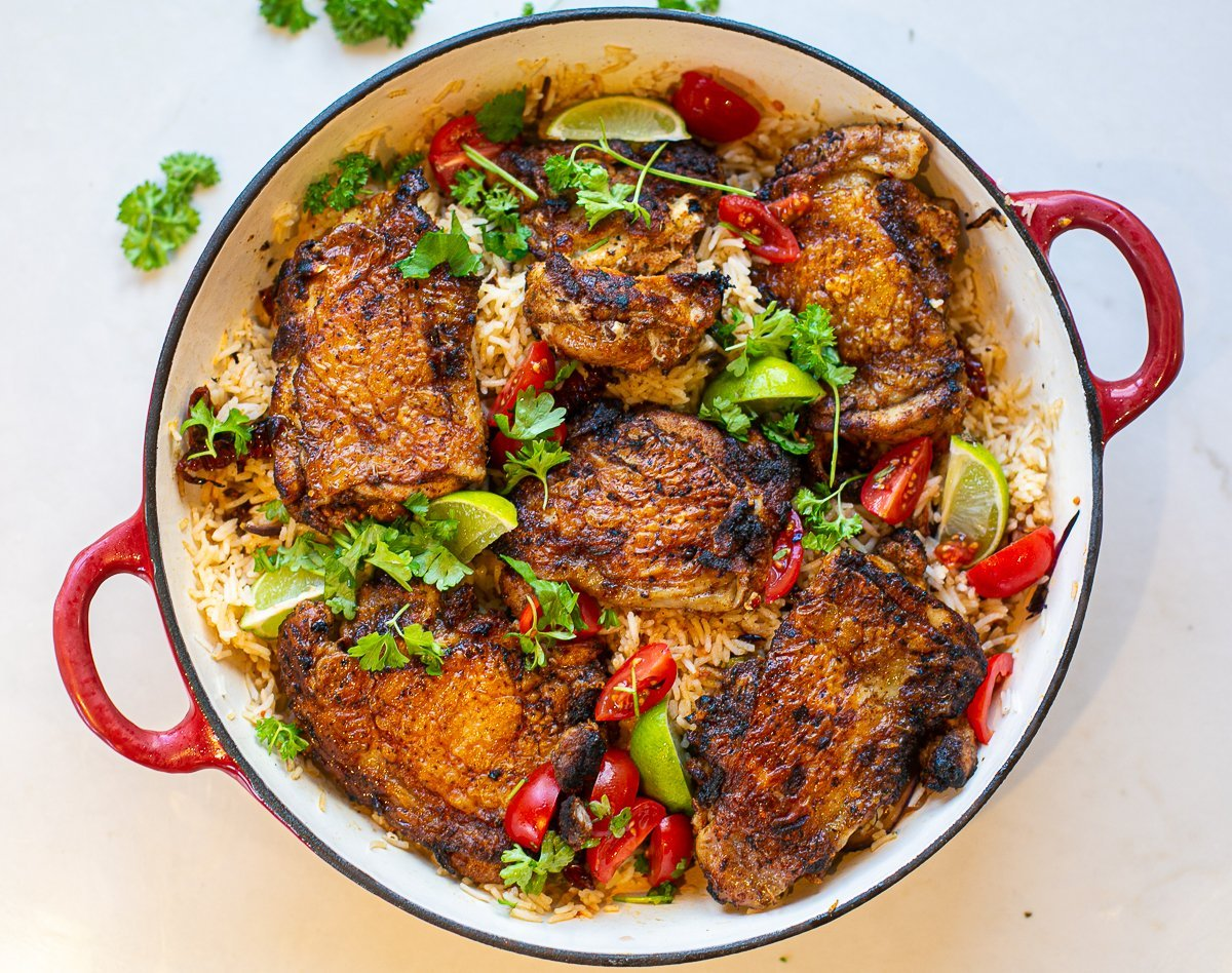 crispy marinated chicken thighs served on dirty rice