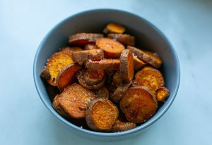 paprika spiced roasted sweet potato fries in a bowl with sea salt